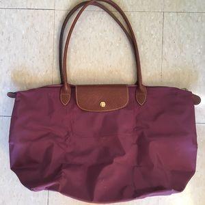 Longchamp Maroon Bag.